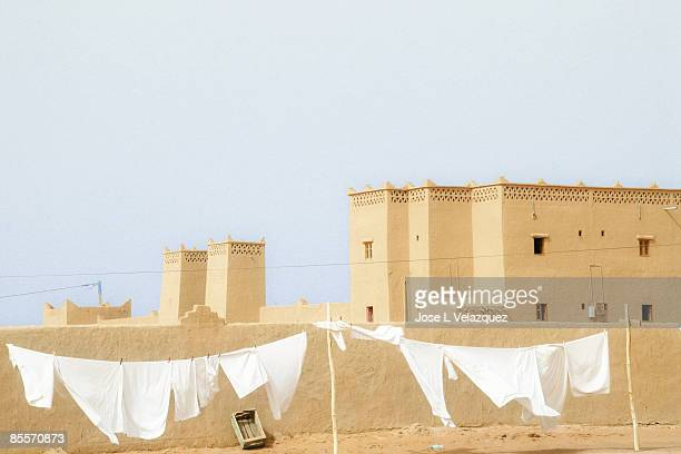clean white clothes hanging at the desert - merzouga stock pictures, royalty-free photos & images