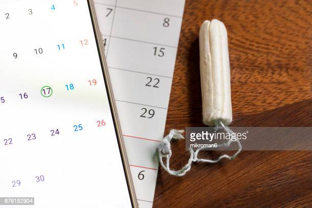 Clean white tampons, mobile phone and Calendar