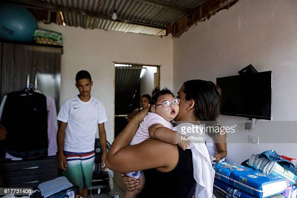 Cleane Stephanny with Maria Eduarda only 11 months Maria Eduarda has microcephaly caused by Zika virus in the city of Olinda state of Pernambuco...