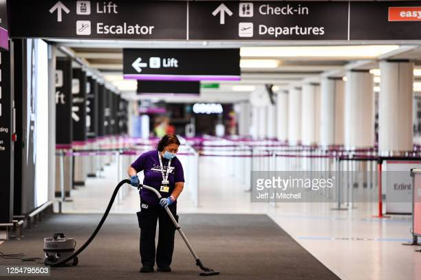 A cleaner at the main terminal at Edinburgh Airport on July 07 2020 in Edinburgh Scotland Scotland has not yet agreed to the UK government's plan for...