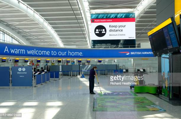 Cleaner at work in an empty Terminal 5 at Heathrow Airport on April 15, 2020 in London, United Kingdom. The airport expects 90% fewer passengers...
