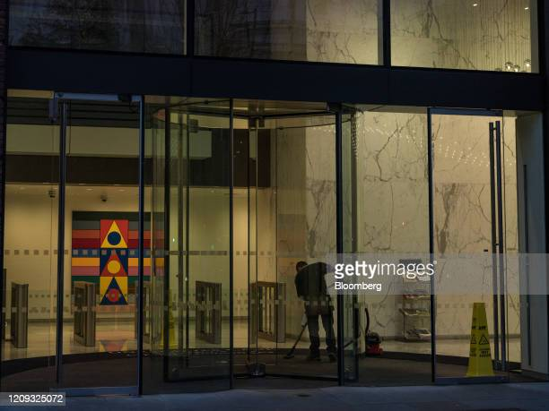 A cleaner operates a vacuum cleaner inside the reception of an office building in the City of London UK on Monday April 6 2020 UK consumer confidence...