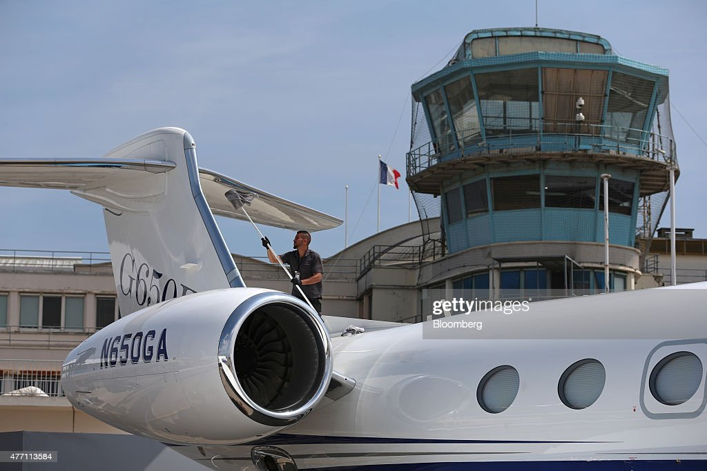 A cleaner polishes the tail fin of a Gulfstream business jet, manufactured by Aerospace Corp., during preparations ahead of the 51st International Paris Air Show in Paris, France, on Sunday, June 14, 2015. The 51st International Paris Air Show is the world's largest aviation and space industry exhibition and takes place at Le Bourget airport June 15 - 21. Photographer: Jasper Juinen/Bloomberg via Getty Images