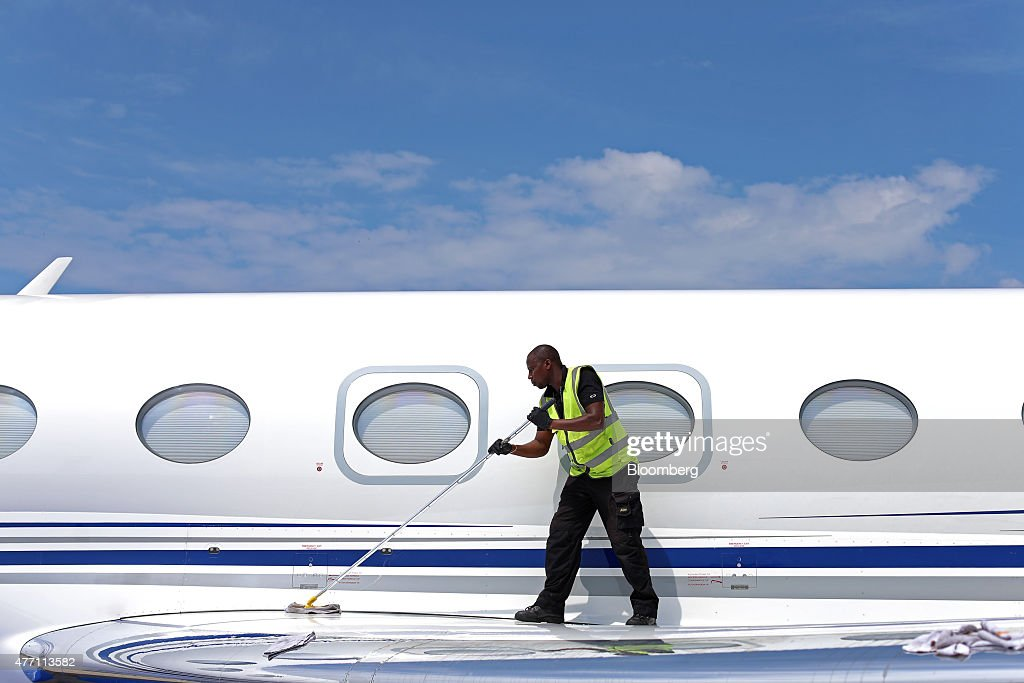 A cleaner polishes the wing of a Gulfstream business jet, manufactured by Aerospace Corp., during preparations ahead of the 51st International Paris Air Show in Paris, France, on Sunday, June 14, 2015. The 51st International Paris Air Show is the world's largest aviation and space industry exhibition and takes place at Le Bourget airport June 15 - 21. Photographer: Jasper Juinen/Bloomberg via Getty Images