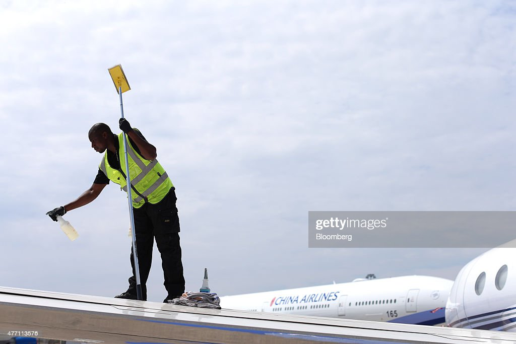A cleaner sprays fluid onto the wing of a Gulfstream business jet, manufactured by Aerospace Corp., before polishing in preparations ahead of the 51st International Paris Air Show in Paris, France, on Sunday, June 14, 2015. The 51st International Paris Air Show is the world's largest aviation and space industry exhibition and takes place at Le Bourget airport June 15 - 21. Photographer: Jasper Juinen/Bloomberg via Getty Images