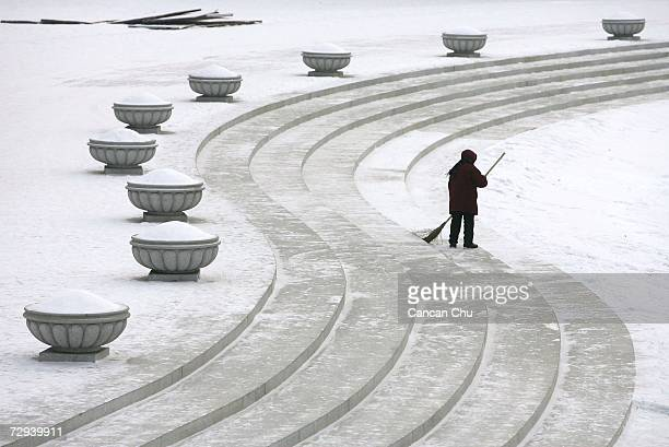 A cleaner sweeps snow at Sun Island during the 23rd Harbin International Ice and Snow Festival January 6 2007 in Harbin Heilongjiang Province in...