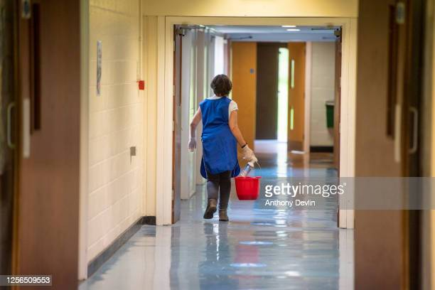 A cleaner walks along a corridor at Longdendale High School on July 16 2020 in Hyde England The Government plan to spend GBP 1 billion to help pupils...