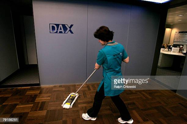 A cleaner wipes the floor of the stock exchange January 22 2008 in Frankfurt Germany The German stock market remains volatile after stock markets in...