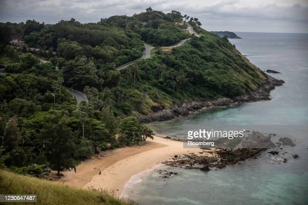 Cleaner works at a deserted beach in Phuket, Thailand, on Sunday, Dec. 20, 2020. The tepid response to Thailands highly publicized reopening...