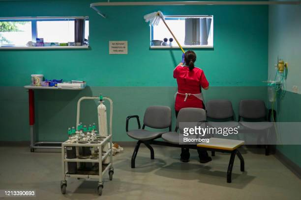 Cleaner works in the X-Ray department at The Royal Blackburn Teaching Hospital, operated by East Lancashire NHS Trust, in Blackburn, U.K., on...