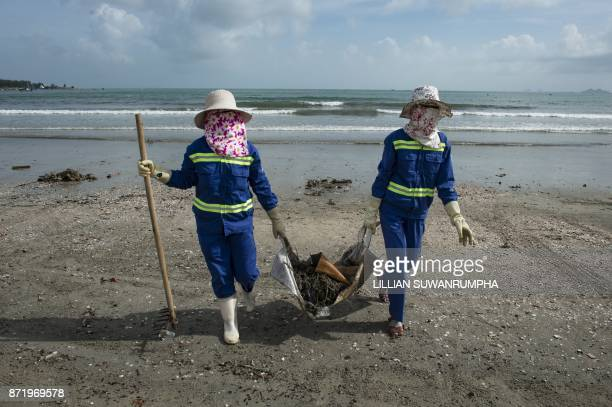 TOPSHOT Cleaners gather debris on the beach in the central Vietnamese city of Danang on November 9 2017 as the city gears up for the AsiaPacific...