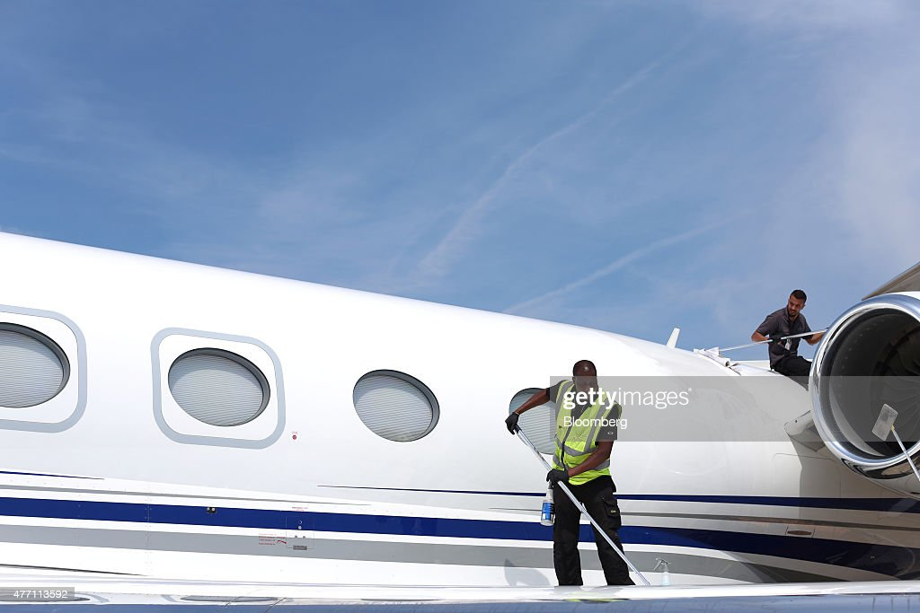 Cleaners polish the fuselage and engine nacelle of a Gulfstream business jet, manufactured by Aerospace Corp., during preparations ahead of the 51st International Paris Air Show in Paris, France, on Sunday, June 14, 2015. The 51st International Paris Air Show is the world's largest aviation and space industry exhibition and takes place at Le Bourget airport June 15 - 21. Photographer: Jasper Juinen/Bloomberg via Getty Images