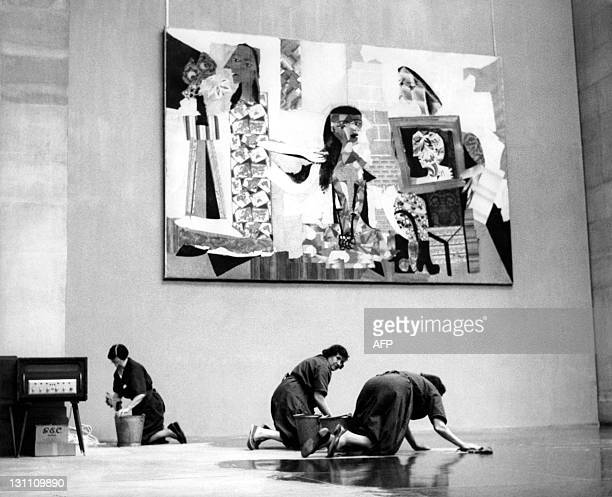 Cleaners preparing the Tate Gallery in London for the exhibition of a retrospective exhibition of Picasso's paintings The picture seen in the...