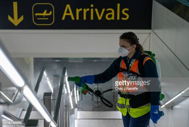 Cleaners spray a peroxide based disinfectant on handrails and surfaces as a protective measure against the spread of the coronavirus inside the...