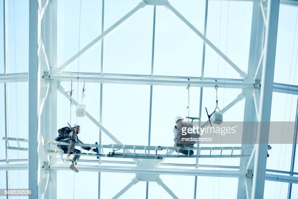 Cleaners washing panoramic windows