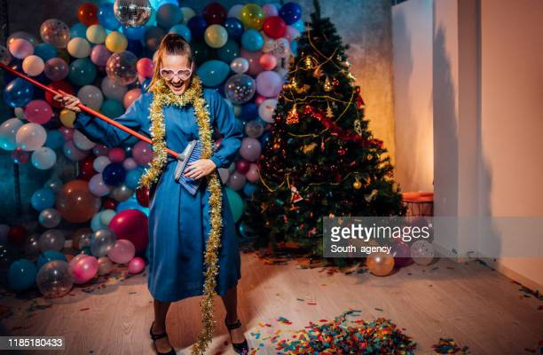 cleaning and dancing after new year party - clean up after party stock pictures, royalty-free photos & images