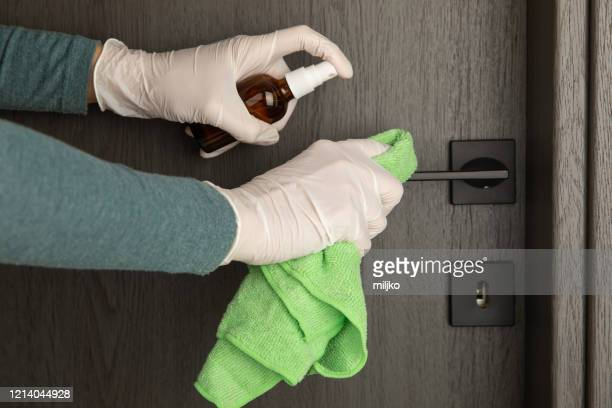 cleaning and disinfection of door handle - antiseptic stock pictures, royalty-free photos & images