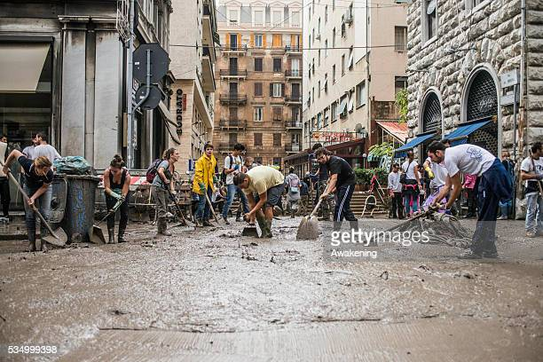 Cleaning and repairing is under way in Genoa after flood waters swept through the city of Genoa overnight smashing shop windows washing away cars and...