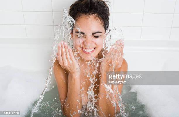 cleaning and splashing on face - taking a bath stock pictures, royalty-free photos & images