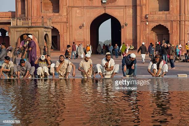 cleaning before praying at jama masjid in new delhi india