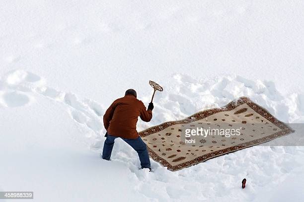 Cleaning carpet in snow