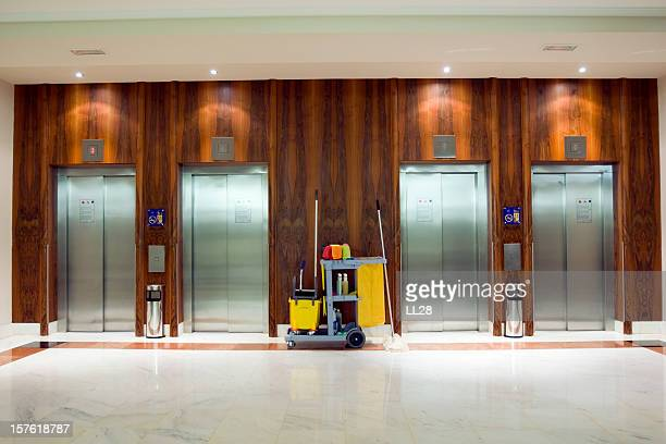cleaning cart at the elevators - commercial cleaning stock photos and pictures
