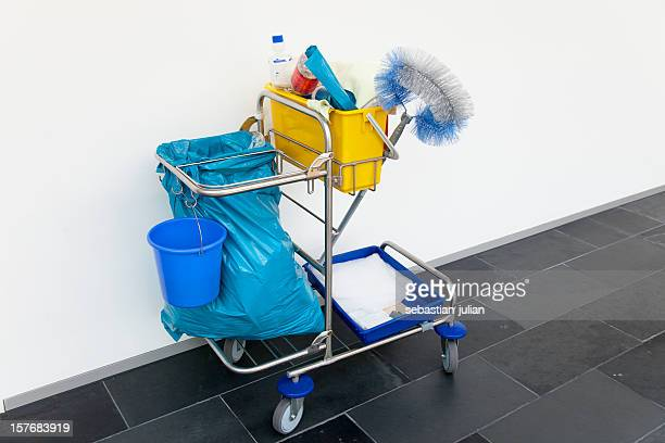 cleaning cart in front of a white wall at office
