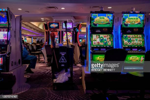 A cleaning cart is seen next to slot machines at the Mirage Hotel and Casino in Las Vegas Nevada on March 13 as some restaurants and buffets along...