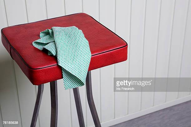A cleaning cloth on a stool