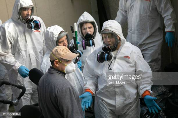A cleaning crew exits the Life Care Center on March 11 2020 in Kirkland Washington Most of the coronavirus deaths in Washington State have been...