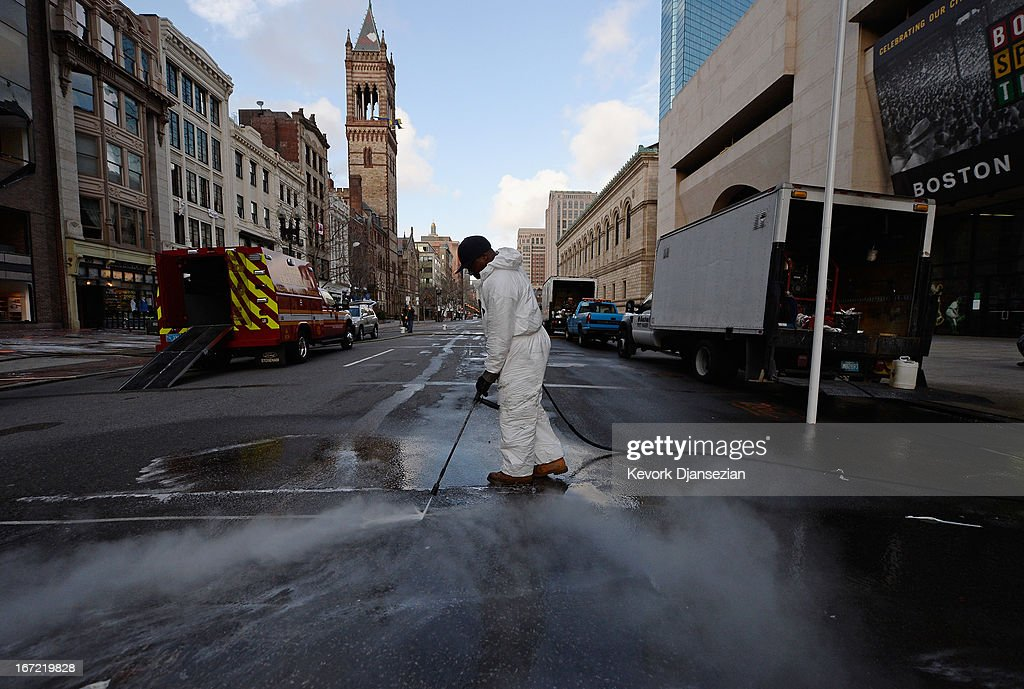 A cleaning crew steam washes Boylston Street across from the blast site near the Boston Marathon finish line one week after the FBI handed it back to the city on April 22, 2013 in Boston, Massachusetts. A manhunt ended for Dzhokhar A. Tsarnaev, 19, a suspect in the Boston Marathon bombing after he was apprehended on a boat parked on a residential property in Watertown, Massachusetts. His brother Tamerlan Tsarnaev, 26, the other suspect, was shot and killed after a car chase and shootout with police. The bombing, on April 15 at the finish line of the marathon, killed three people and wounded at least 170.
