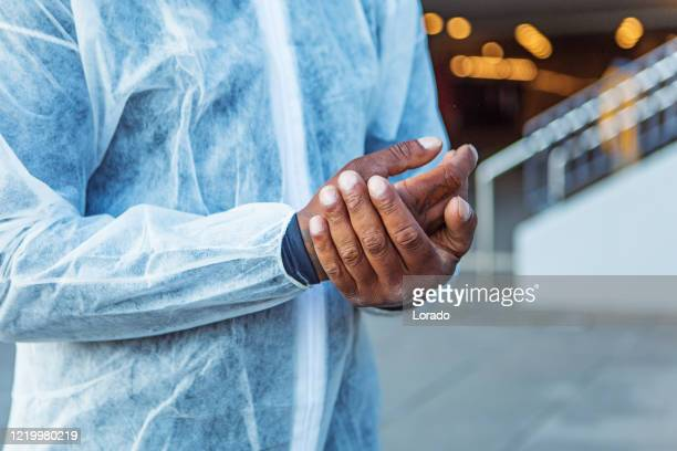 cleaning hands at a security checkpoint during corona virus outbreak - essential services stock pictures, royalty-free photos & images