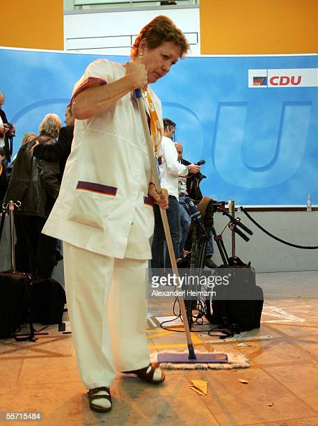 Cleaning lady clears the floor after CDU's election party on September 18, 2005 in Berlin, Germany. As 62 million Germans are called to elect the...