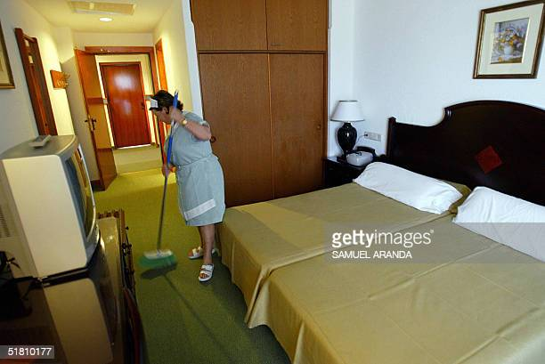 A cleaning lady works in a room of Spanish RIU group's Oliva Beach hotel in Corralejo on Fuerteventura Island Spain 01 December 2004 The Spanish...