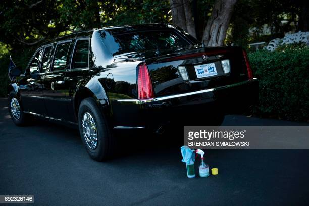Cleaning materials are seen before one of US President Donald Trump's armored limousines before departing the White House June 4 2017 in Washington...