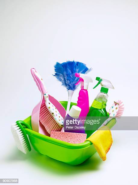 Cleaning materials in bowl including, mop, dustpan