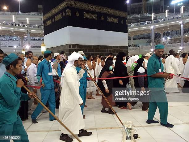 Cleaning personnel clean the ground of the Mataf the open area around the Kaaba during the constructions for extension project of the Mataf continue...