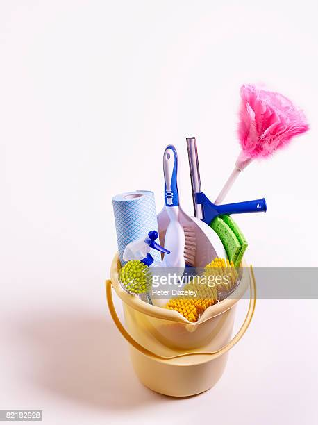 Cleaning products and equipment in bucket