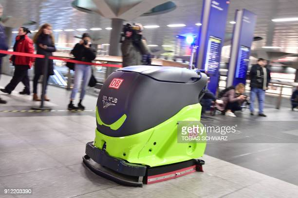 A cleaning robot by Adlatus Robotics takes part in a parcours event hosted by German rail operator Deutsche Bahn at Berlin's main central station on...