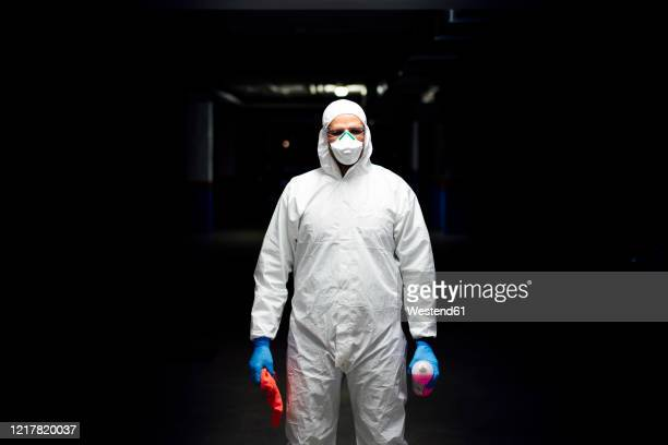 cleaning staff in suit with sanitizer and cleaning cloth - cleaner stock pictures, royalty-free photos & images