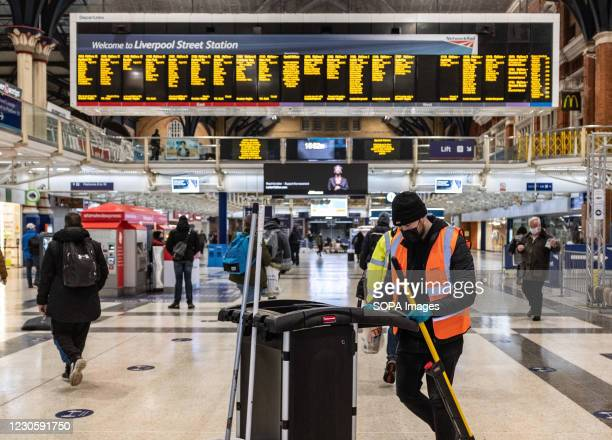 Cleaning staff wearing facemask at the Liverpool street station in London. London has recorded a further 10,020 coronavirus cases in the past 24...