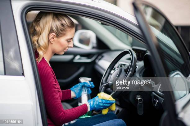 cleaning steering wheel - car stock pictures, royalty-free photos & images