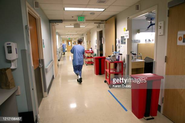 Cleaning supplies and waste bins line the hallways of the acute care COVID unit at Harborview Medical Center on May 7 2020 in Seattle Washington...