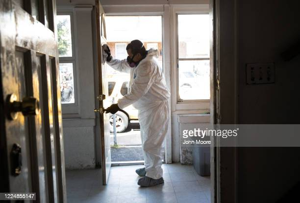 A cleaning technician wearing PPE deep cleans the home of Zully Marvin and Junior on May 14 2020 in Stamford Connecticut The Guatemalan family have...