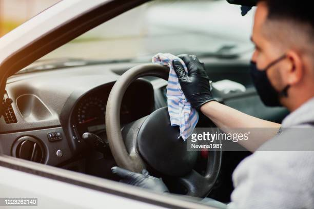 cleaning the car steering wheel - dettol stock pictures, royalty-free photos & images