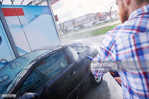 cleaning the car with a pressure washer. debica, poland - car wash brush stock photos and pictures