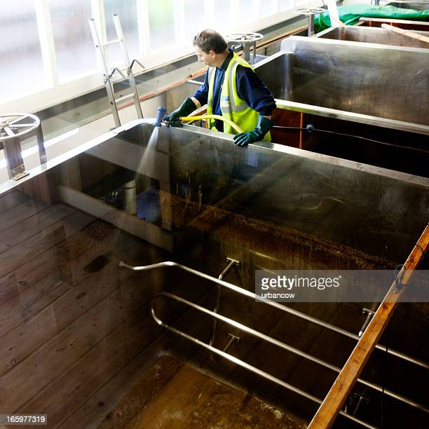 cleaning the fermentation tanks - storage tank stock photos and pictures