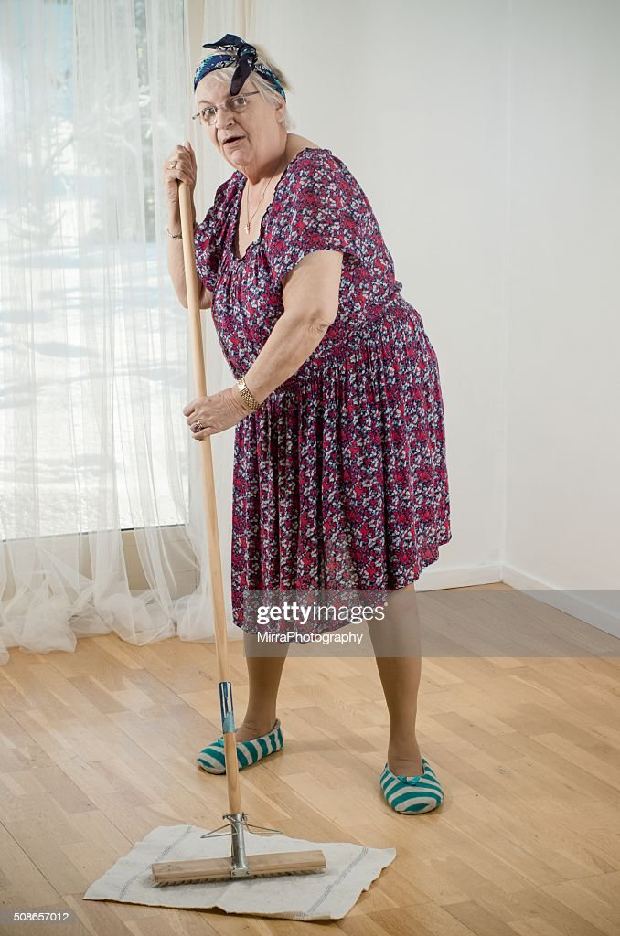 Cleaning the wooden floor : Stock Photo
