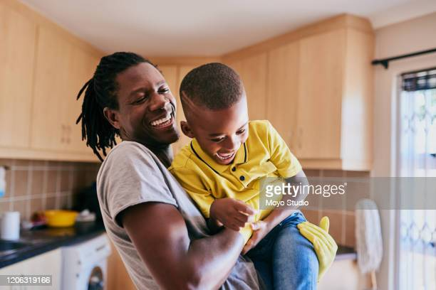 cleaning time doesn't have to be all boring - african ethnicity stock pictures, royalty-free photos & images