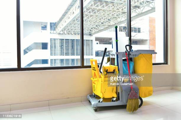 Cleaning tools cart wait for cleaning,Yellow mop bucket and set of cleaning equipment in the airport